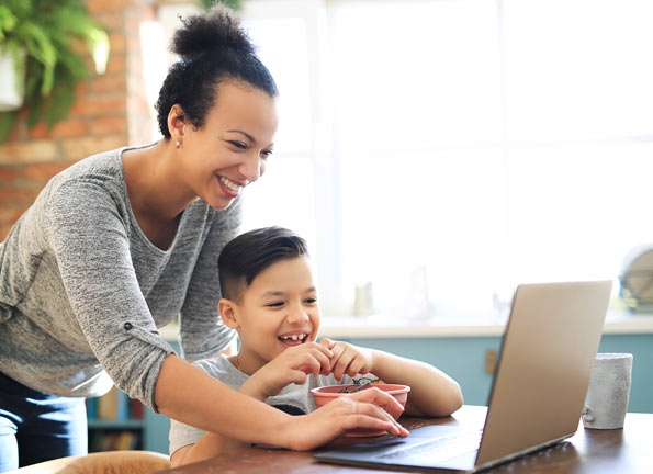 Mother and child using a laptop connected to Fongo Internet