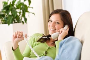 Woman on fongo home phone device